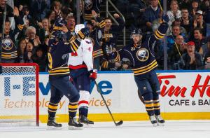 Drew Stafford #21 of the Buffalo Sabres celebrates his second period goal against the Washington Capitals with teammate Steve Ott #9 on December 29, 2013 at the First Niagara Center in Buffalo, New York. (Photo by Bill Wippert/NHLI via Getty Images)