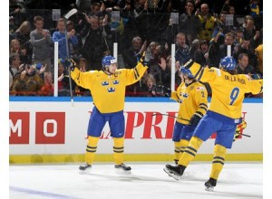 Sweden's Filip Forsberg #16 celebrates with Jacob de la Rose #9 after a first period goal against Switzerland during preliminary round action at the 2014 IIHF World Junior Championship. (Photo by Andre Ringuette/HHOF-IIHF Images)