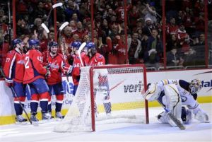 Washington Capitals center Marcus Johansson, third from left, of Sweden, celebrates his goal with teammates Karl Alzner (27), Joel Ward (42), Steven Oleksy (61) and Mathieu Perreault (85) as Buffalo Sabres goalie Ryan Miller (30) looks on during the second period of an NHL hockey game, Sunday, March 17, 2013, in Washington. (AP Photo/Nick Wass)