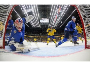 Finland's Ville Husso #30 looks behind him as Sweden's Andreas Johnson #5 celebrates after Alexander Wennberg's #10 first period goal during preliminary round action at the 2014 IIHF World Junior Championship. (Photo by Andre Ringuette/HHOF-IIHF Images)