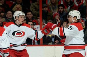 Jeff Skinner #53 and John-Michael Liles #26 of the Carolina Hurricanes celebrate Skinner's first-period goal during an NHL game against the Washington Capitals at Verizon Center on January 2, 2014 in Washington, DC. (Photo by Patrick McDermott/NHLI via Getty Images)