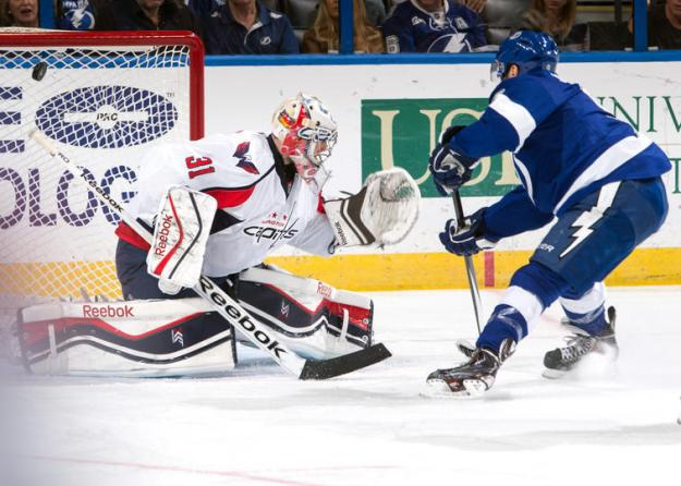 Tyler Johnson #9 of the Tampa Bay Lightning shoots the puck by goalie Philipp Grubauer #31 of the Washington Capitals for a goal during the first period at the Tampa Bay Times Forum on January 9, 2014 in Tampa, Florida. (Photo by Scott Audette/NHLI via Getty Images)