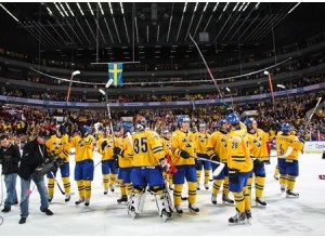 Swedish players thanked the fans for their support after defeating Russia during semifinal round action at the 2014 IIHF World Junior Championship. (Photo by Francois Laplante/HHOF-IIHF Images)