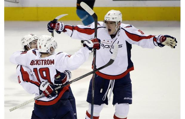 Ovechkin and Carlson hug Backstrom after his shootout winner to give the Capitals an important 3-2 win. (EdmontonJournal.com)